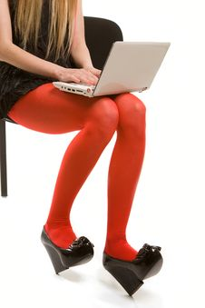 Woman S Legs In Red Stockings And Laptop