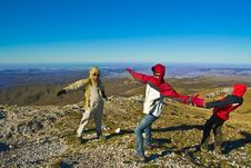 Happy Hikers In Mountains Playing With Strong Wind Stock Images