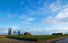 Free Windmill And Clouds Royalty Free Stock Image - 9636236