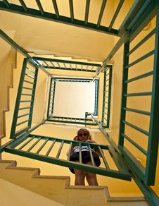 Free Girl Stands On The Spiral Staircase Stock Photo - 9639560