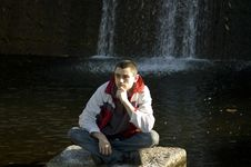 Free Man Sitting On A Stone Royalty Free Stock Photos - 9639698
