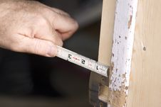 Free Man Measuring Door Jam Royalty Free Stock Image - 9640096
