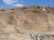 Free Prayer Mantra On A Rock Royalty Free Stock Photos - 9640698