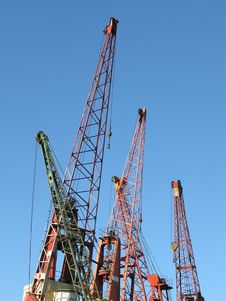 Several Cranes In A Harbor Stock Photos