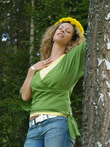 Free Curly Girl With Dandelion Chain On Head Stock Photo - 9643400