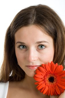 Beautiful Woman With A Bright Red Flower Royalty Free Stock Images