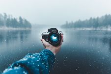 Free Reflection Of Man Photographing In Snow Royalty Free Stock Images - 96494439
