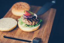 Free Shallow Focus Photography Of Burger Sandwich Served On Brown Wooden Chopping Board Royalty Free Stock Photography - 96494887