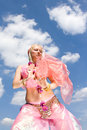 Free A Woman In Pink Dancing And A Blue Sky Royalty Free Stock Images - 9650049