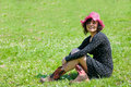 Free Woman Sitting On A Flowery Meadow Stock Image - 9659121