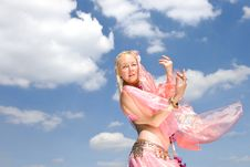A Woman In Pink Dancing And A Blue Sky Royalty Free Stock Photo