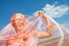 Free A Woman Cover Her Face With A Pink Dress Stock Image - 9650191