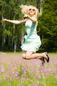 Free Young Woman In Pink Flowers Jumping Royalty Free Stock Images - 9650499