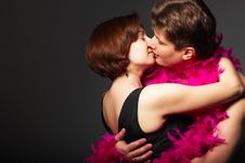 A Young Couple Kissing Each Other Stock Photo