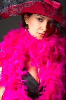 Beautiful Woman In Pink Feathers And Hat Stock Photo