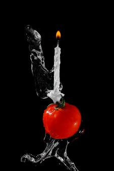 Free Tomato And Candle In Water Stream Royalty Free Stock Photo - 9651145