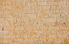 Wall Built Of Yellow Stone Blocks Stock Image