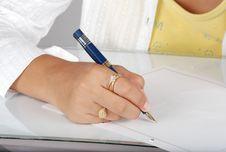 Free Girl Writing On Pad Stock Photos - 9651563