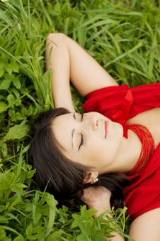 Free Beautiful Girl Lying On The Grass Stock Photo - 9652520
