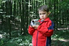 Boy With A Camera Stock Photography
