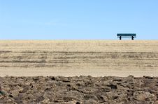 Lonely Bench On A Dike Royalty Free Stock Image