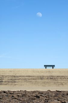 Lonely Bench On A Dike Stock Images
