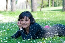 Free Smiling Girl Lying On A Flowery Meadow Royalty Free Stock Photos - 9659068