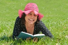 Free Smiling Girl Lying On A Meadow Reads A Book Royalty Free Stock Photo - 9659225