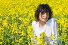 Relaxing Young Woman In The Rapeseed Yellow Field Royalty Free Stock Image