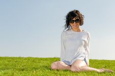 Free Smiling Girl Sitting On The Grass With Blue Sky Royalty Free Stock Photography - 9659727