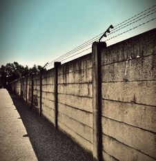 Free Beige And Black Concrete Wall With Barbwire On Top Stock Images - 96501804