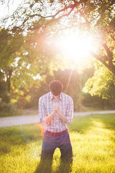 Free Man Wearing Longsleeves Shirt And Denim Jeans Kneeling On Grass During Daytime Stock Photo - 96502480