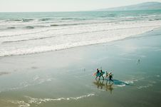 Free Surfers On Beach Stock Images - 96542564