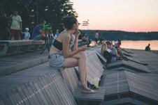Free A Girl Sitting At The Lake In The City Royalty Free Stock Images - 96542639