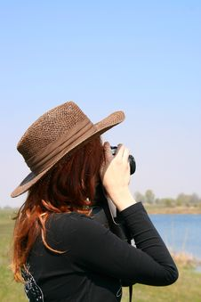 The Girl In The Hat With The Camera Stock Photos