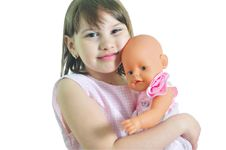 Free Smiling Girl With Doll Stock Photo - 9668880