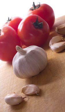 Garlic And Tomatoes Stock Photo