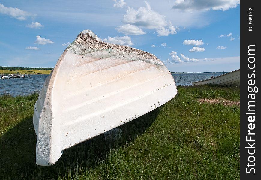 Beach landscape -Fishermen Skiff boat on the sand