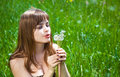 Free Young Girl Blowing On Dandelion Royalty Free Stock Images - 9676789