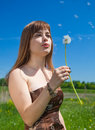 Free Young Girl Blowing On Dandelion Stock Image - 9677021