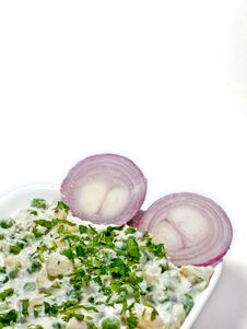 Free Baked Vegetable In A Whit Bowl And Two Onions Royalty Free Stock Images - 9671179