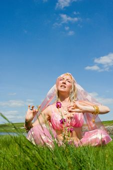 Free A Woman In Pink Asian Dress Singing Stock Photos - 9673413