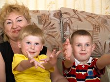 Portrait Of The Grandmother With The Grandsons Stock Photos