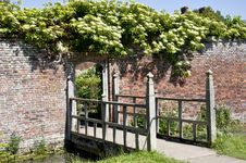 Bridge Into The Walled Garden Stock Images