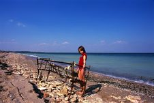 Girl Playing Near Balck Sea Stock Photos