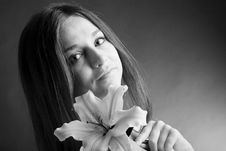 Free Young Woman Posing With A Lily Royalty Free Stock Image - 9678026