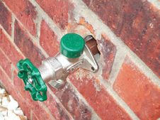 Free Water Spigot Outside Green Brick Building Stock Photos - 9679373
