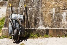Free Wheelbarrow On Wall Stock Photography - 9679842