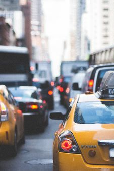 Free Yellow Altima Taxi Surrounded By Vehicles During Daytime Stock Images - 96793174