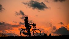 Free Silhouette Of Person Riding A Bike During Sunset Royalty Free Stock Photo - 96793175